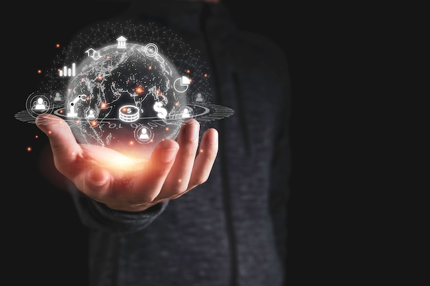 Hand holding virtual global network with business icons such as graph dollar sign. business investment transformation by use artificial intelligence analysis big data is important. Premium Photo
