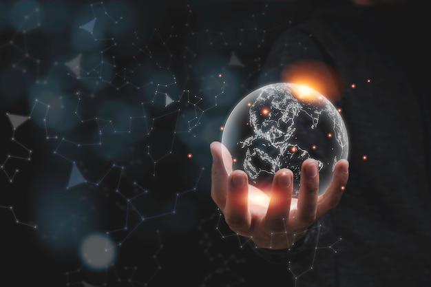 Hand holding virtual world with orange light. environment conservation concept. Premium Photo