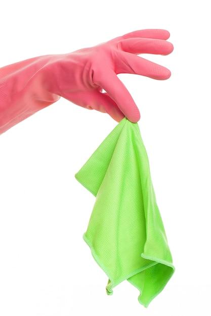 布を保持しているピンクの手袋で手します。 無料写真