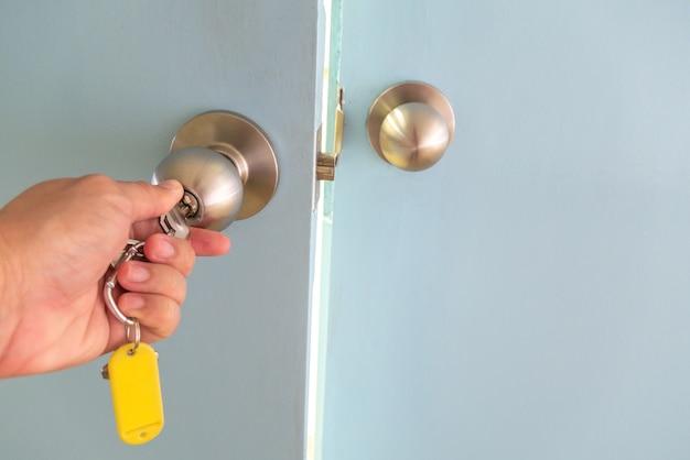 The hand is unlocking door Premium Photo