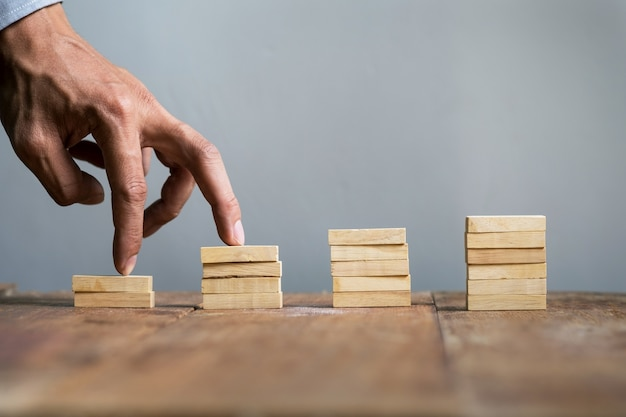 Hand liken business person jump a toy staircase to success, business concept Premium Photo