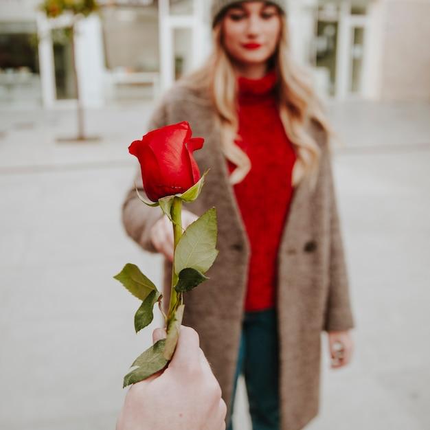 guy giving girl roses