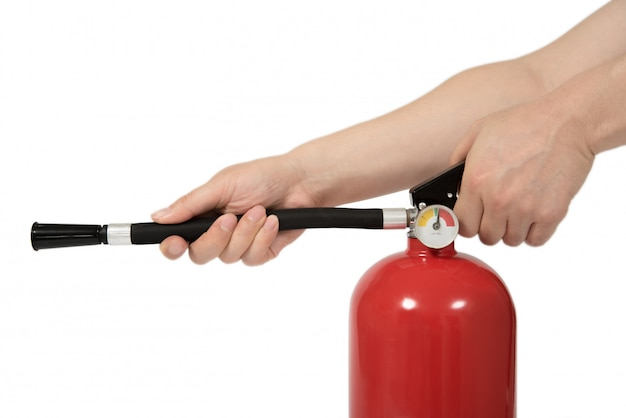 The hand of the man holding the fire extinguisher. Premium Photo
