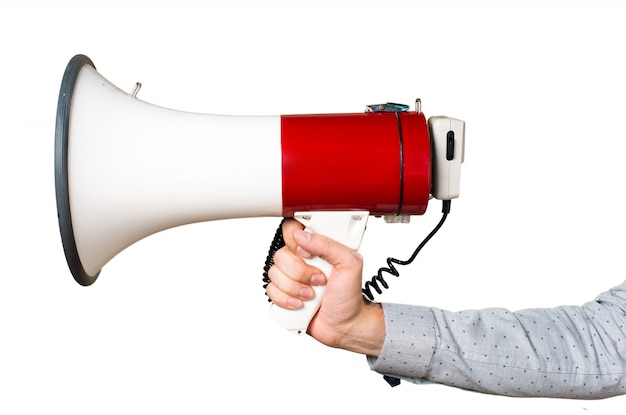 Hand of man holding shouting by megaphone Free Photo