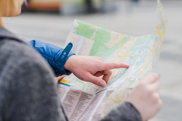 Hand of man pointing at map Free Photo