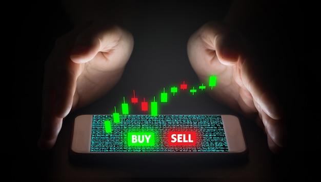Hand man using smartphone trading with virtual screen. Premium Photo
