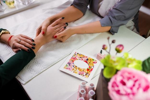 Hand massage on manicure Premium Photo