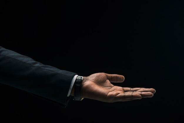 Hand of black businessman Free Photo