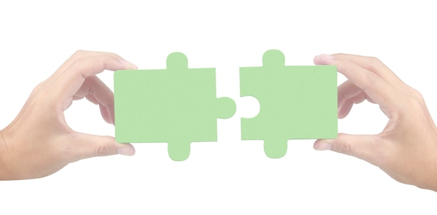 고립 된 지 그 소 퍼즐 연결의 손 프리미엄 사진