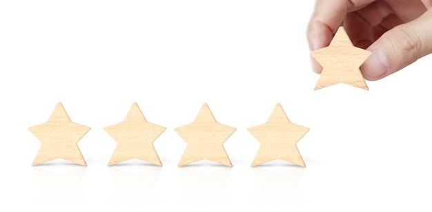 置く手は木五つ星形を増やします Premium写真