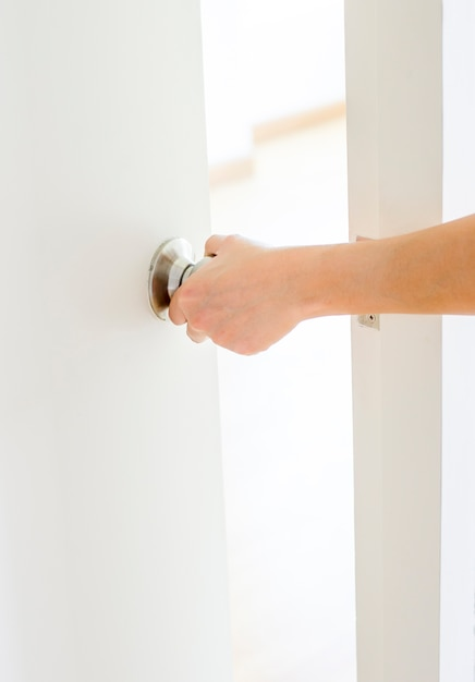 Hand Opening Door Knob,white Door Premium Photo