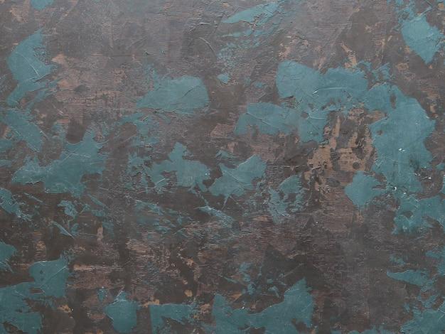 手描きの黒の背景の抽象的な油で痛んだキャンバスブルー、ブラウン、グリーンのブラシストローク。 Premium写真