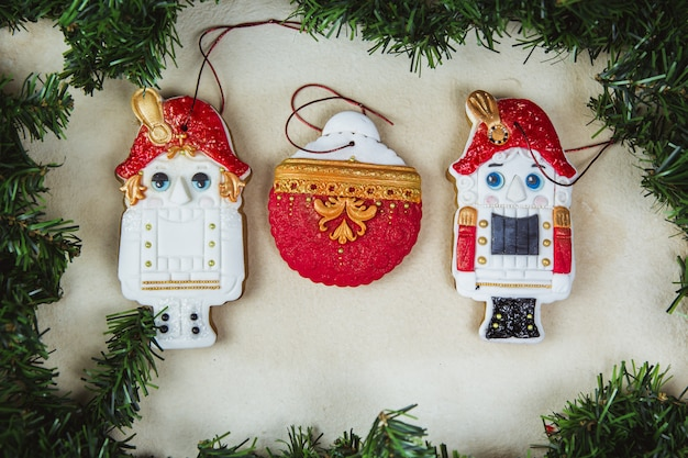 Hand painted christmas gingerbread nutcracker on a beautiful beige . card . top view. flat lay. Premium Photo