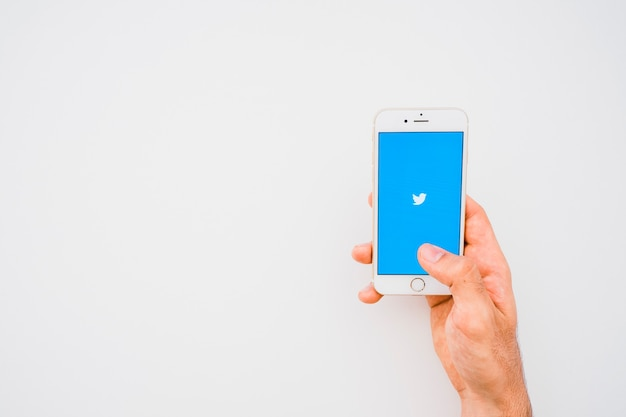 Hand, phone, twitter app and copy space Free Photo
