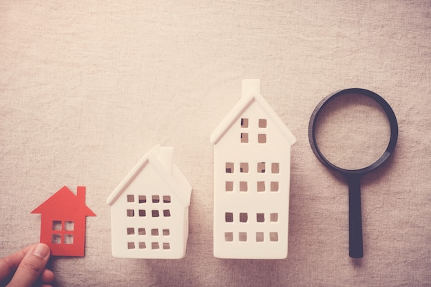 Hand picking the right house property, house searching concept Premium Photo