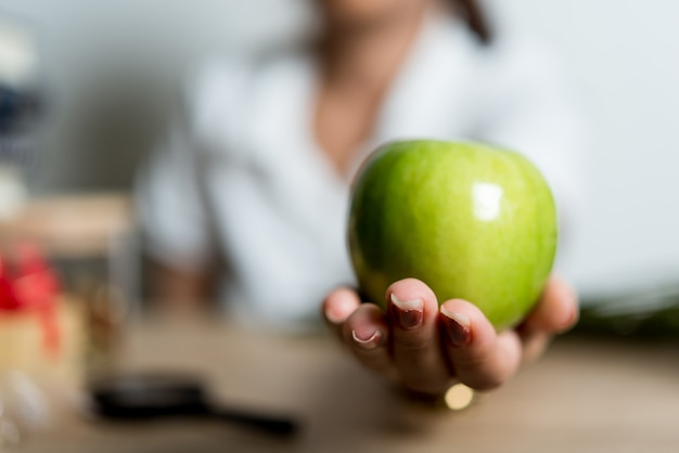Hand pictures and green apples creative ideas with copy space Premium Photo