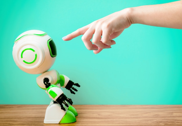 Hand pointing person and robot technology human substitution work Premium Photo