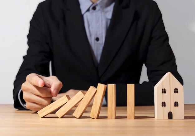 Hand pressing wooden domino blocks Premium Photo