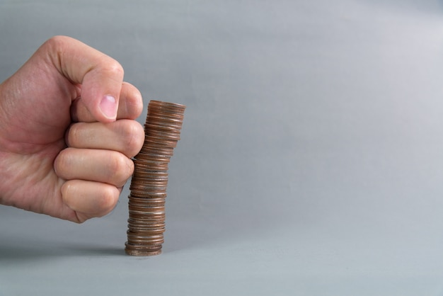 Hand punch the increasing columns of coins Premium Photo