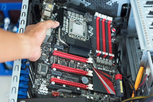 Hand put mainboard with cpu into atx computer case with cable Premium Photo