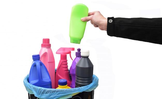 Hand put a plastic bottle in a recycling bin Premium Photo