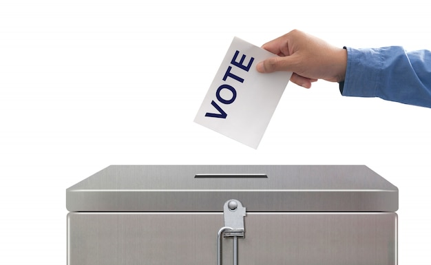 Hand putting voting paper, elections and democracy concept Premium Photo