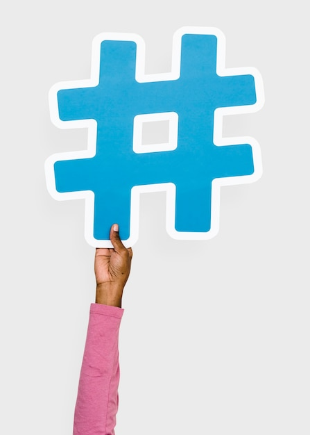 Hand raised holding hashtag icon Free Photo