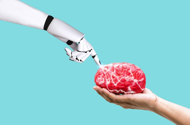 Hand robot brain concept ai in command memory on human hand holding Premium Photo