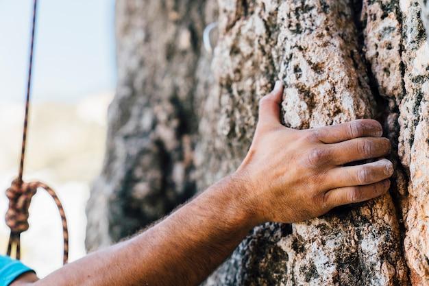 Hand of rock climber Free Photo