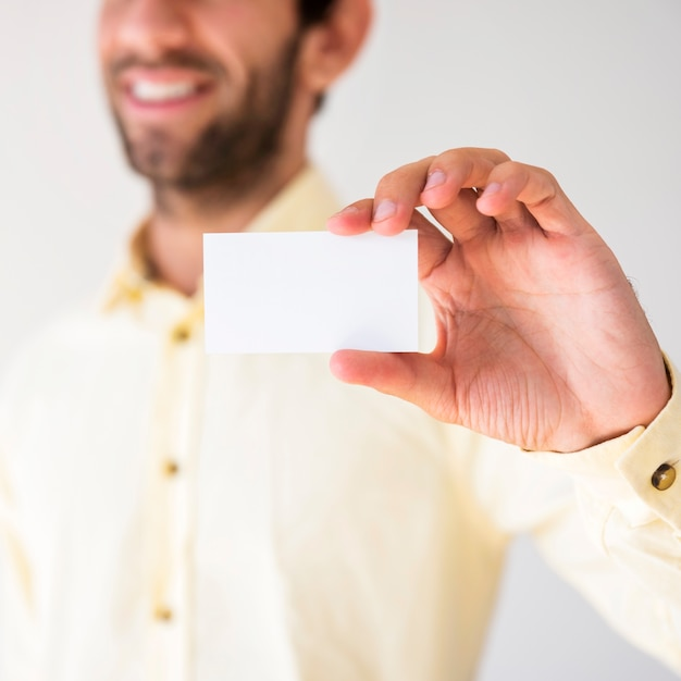 Hand showing a blank business card Free Photo