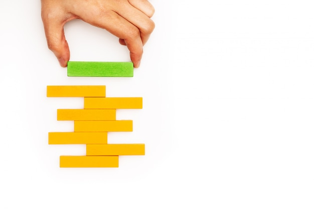 Hand stacking wooden block with copy space Premium Photo