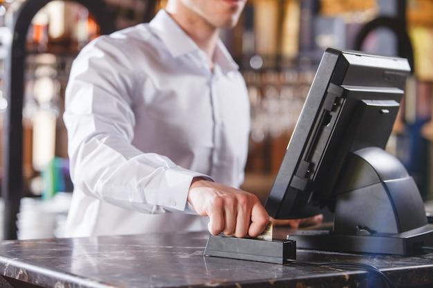 Hand swiping credit card in store. Premium Photo