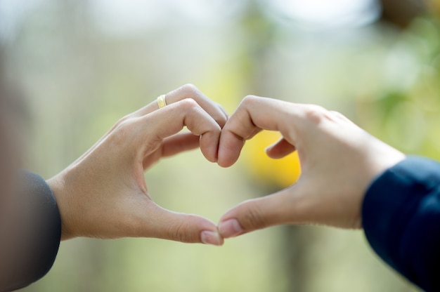 A hand that shows love to lovers on the day of love love day with copy space Premium Photo