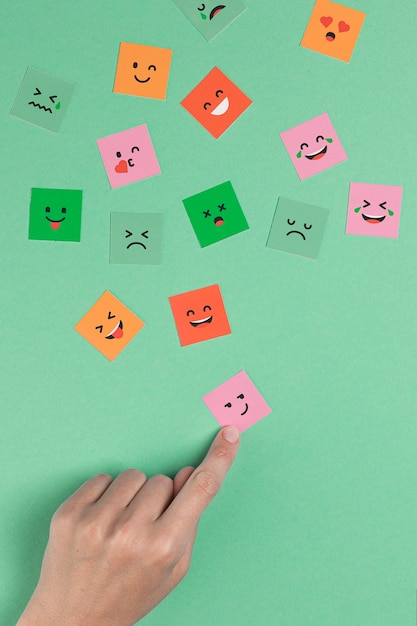Hand touching  a square smiling face Free Photo