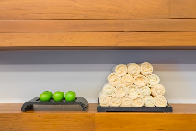 Hand towel in fitness club with green apple photo free