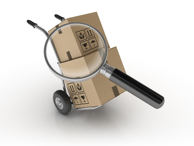 Hand truck and cardboard boxes with magnifiying glass Premium Photo