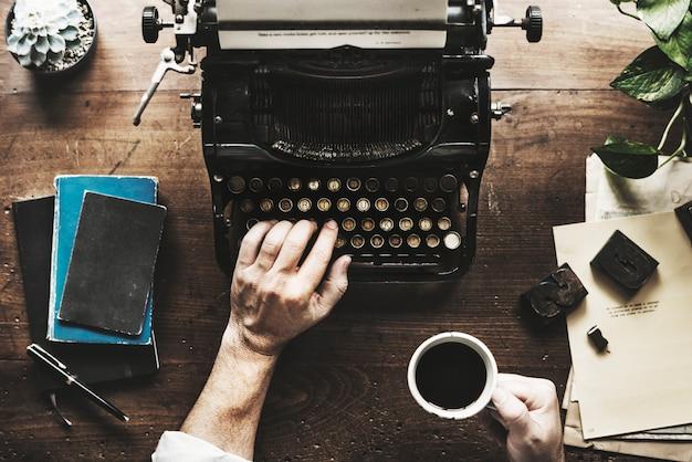 Hand typing retro typewriter machine work writer Premium Photo