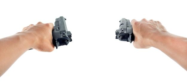 Hand using a hand gun pistol Premium Photo