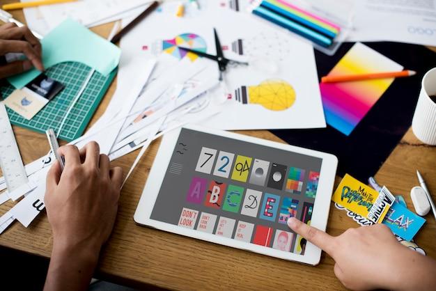 Hand using tablet design graphic Premium Photo