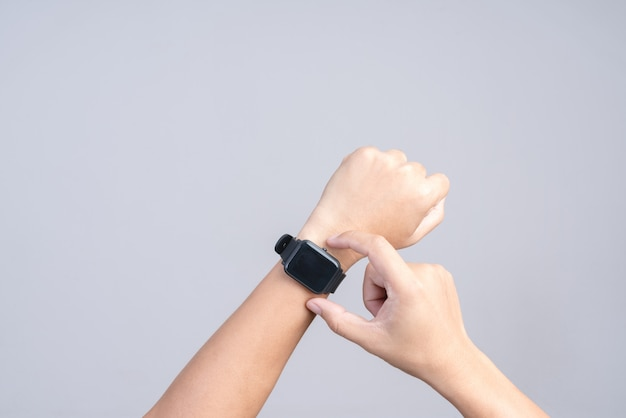 Hand wearing modern smart watch Premium Photo