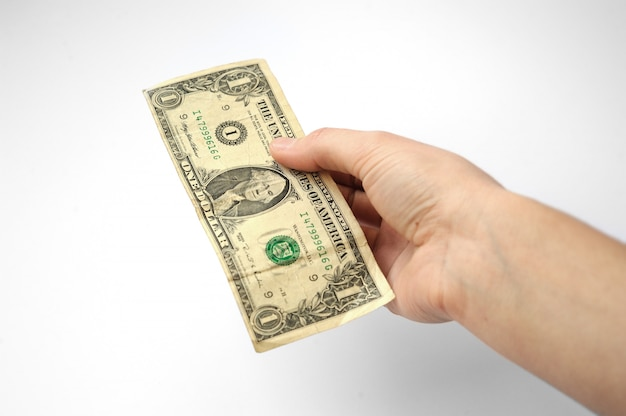 Hand on a white background stretches of banknotes in denomination Premium Photo