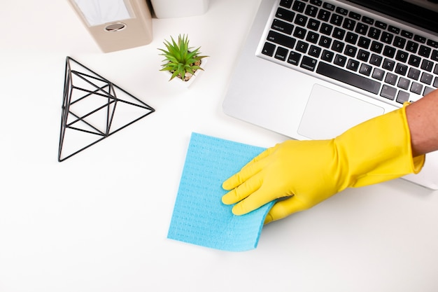 Hand wiping office desk Free Photo