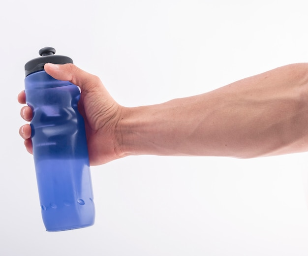 Hand with blue bottle Premium Photo