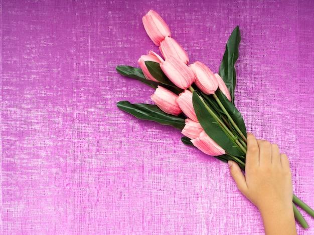 Hand with bunch of tulips Premium Photo