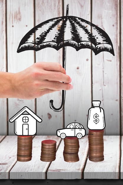 Hand with a drawn umbrella and coins Free Photo