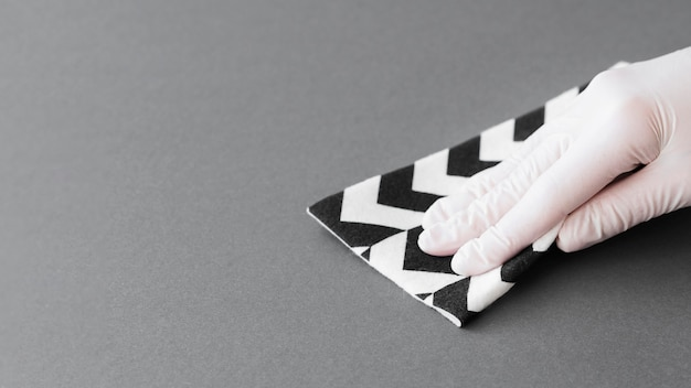 Hand with glove disinfecting surface with copy space Premium Photo
