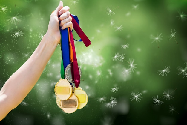 Hand with many medals Free Photo