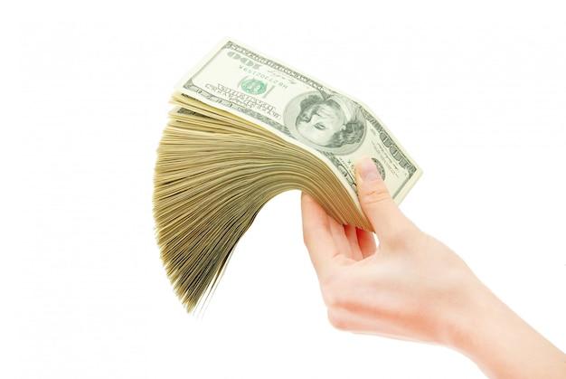 Hand with money isolated on white background Premium Photo