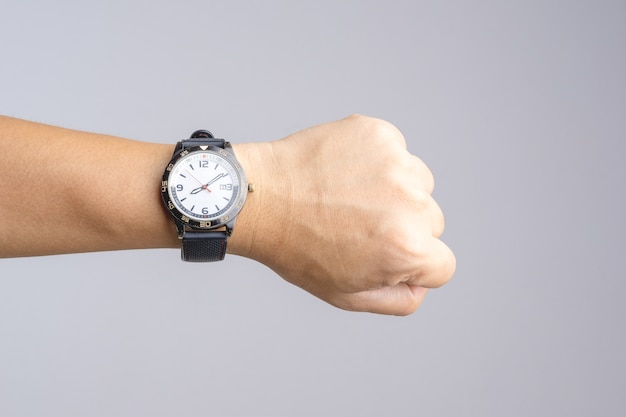 Hand with old and rusty wrist watch showing time over eight o'clock Premium Photo