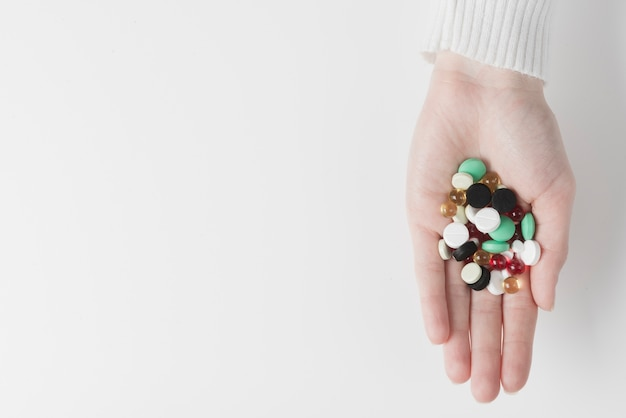 Hand with pile of drugs Free Photo